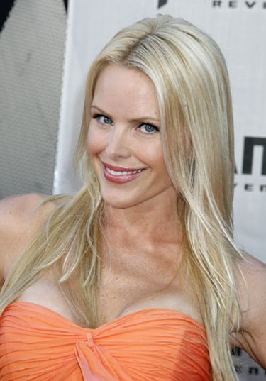 """Former """"Baywatch"""" TV show star Gina Lee Nolin poses at the Los Angeles premiere of """"Transformers: Revenge of the Fallen"""" June 22, 2009. (Fred Prouser, Reuters)"""