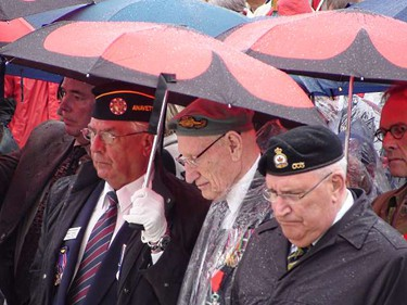 War veterans observe a rainy ceremony on the 65th anniversary of D-Day in Normandy, France, on June 6, 2009. (KATHLEEN HARRIS/SUN MEDIA)