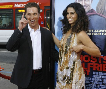 """Cast member Matthew McConaughey gestures next to his girlfriend Brazilian model Camilla Alves at the premiere of """"Ghosts of Girlfriends Past"""". (Mario Anzuoni, Reuters)"""