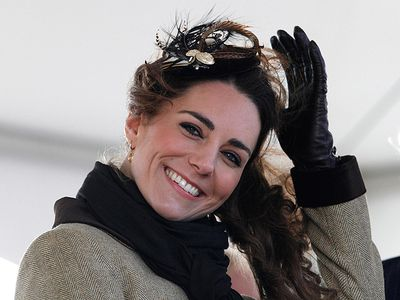 Kate Middleton smiles during her first official engagement with Prince William, since announcing their upcoming wedding. The couple was at a Naming Ceremony and Service of Dedication for the Royal National Lifeboat Institution's new Atlantic 85 Lifeboat, the 'Hereford Endeavour' in Trearddur Bay, Anglesey on February 24, 2011. (REUTERS/Phil Noble)