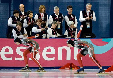 Canada's Kristina Groves (L) leads teammate Christine Nesbitt during the  women's 1500-metre at the World Cup Single Distance Speed Skating Championships in Richmond, British Columbia on March 13, 2009. Groves placed first but was later disqualified for a lane violation while Nesbitt finished in third.   (REUTERS)