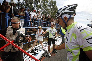 Actor Matt Damon stands at the finish line of the 2009 Argus Cycle Tour in Cape Town March 8, 2009. (REUTERS/Mark Wessels)