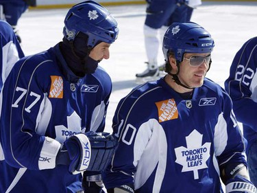 Pavel Kubina (L) and Brad May dressed a little differently to brave the cold at practice today. The Leafs practiced at the outdoor rink in High Park. (CRAIG ROBERTSON/Sun Media)