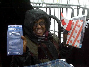 Sandra Jones of Toronto came to Ottawa in hopes to catching a glimpse of U.S. President Barack Obama this morning. She was camped out against one of the Hill barricades before 8 a.m. (LAURA CZEKAJ/Sun Media)