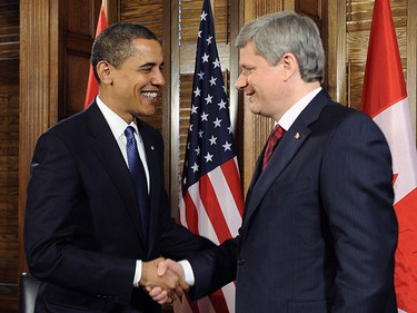 U.S. President Barack Obama (L) and Canadian Prime Minister Stephen Harper meet on Parliament Hill in Ottawa Feb. 19, 2009.     REUTERS/Larry Downing
