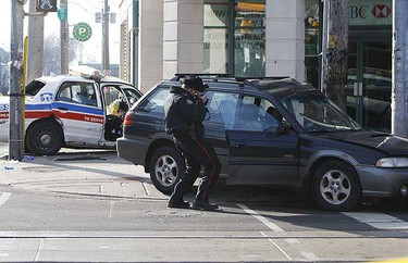A Toronto Police sergeant's cruiser, responding to an emergency call, collided with a Subaru at the intersection of Queen St. E. and Woodbine Ave. during rush hour on Feb. 17, 2009. (JACK BOLAND/Sun Media)