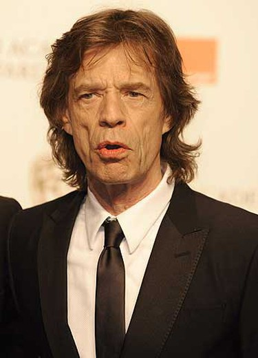 Britain's Mick Jagger poses after presenting an award during the 2009 BAFTA (British Academy of Film and Television Arts) awards ceremony at the Royal Opera House in London Feb. 8, 2009. REUTERS/Toby Melville