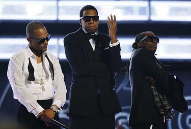 Hip Hop aritists (L-R) T.I., Jay-Z,  and Lil Wayne perform at the 51st annual Grammy Awards in Los Angeles, Feb. 8, 2009.     REUTERS/Lucy Nicholson