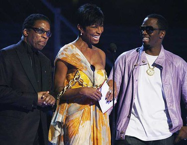 Herbie Hancock, Natalie Cole, and  P. Diddy also known as Sean Combs speak at the 51st annual Grammy Awards in Los Angeles, Feb. 8, 2009.     REUTERS/Lucy Nicholson