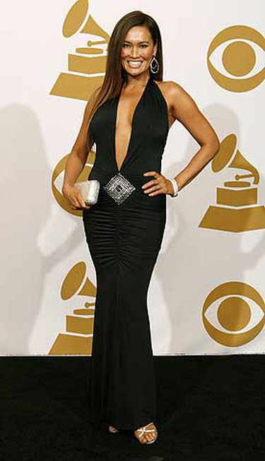 Tia Carrere poses at the 51st annual Grammy Awards in Los Angeles Feb. 8, 2009.     REUTERS/Mario Anzuoni