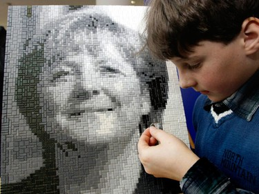 Sven Herschner makes a puzzle portrait of German chancellor Angela Merkel during the press preview of the 60th International Toy Fair in Nuremberg February 4, 2009. More than 2,700 exhibitors from over 60 countries worldwide will present their new toy products from February 5 to February 10, 2009.  (REUTERS)