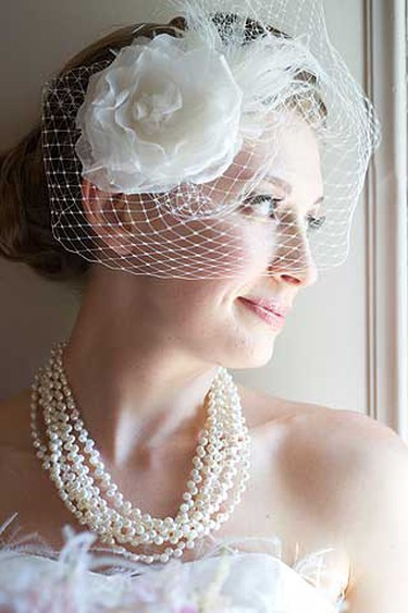 Brides will fancy veils, vintage hats and headpieces to add a dramatic look. Above, a birdcage bridal veil from LaKrause Headwear. (Supplied)