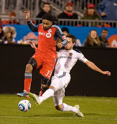 Toronto FC forward Javier Martina gets past the L.A. Galaxy's Todd Dunivant during MLS action at BMO Field, in Toronto, on April 13, 2011. The game ended in a scoreless draw. (MARK O'NEILL/QMI Agency/Toronto Sun)