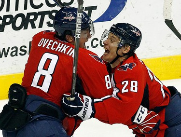 Washington Capitals' Alex Ovechkin (8) celebrates his goal with teammate Alexander Semin against the New York Rangers during the third period of Game 1 of their NHL Eastern Conference quarter-final hockey series in Washington, on April 13, 2011. (REUTERS)
