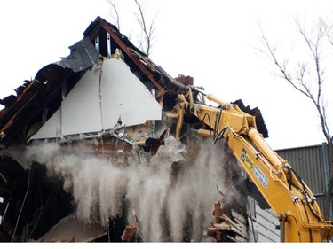 To make way for a new Hwy. 417 offramp, demolition crews started tearing down the homes on the North side of Parkdale Ave., on Monday, April 11. Buckley snapped these shots as the heavy equipment moved in and levelled the first of several former homes which will be taken down. (Alan Buckley submitted photos)