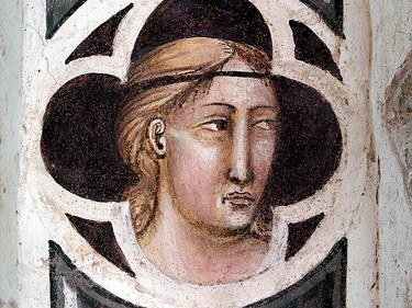 One of the tiny faces that were discovered during the restoration of the 600-year-old Capella Maggiore frescoes is seen in Florence's Santa Croce Basilica, April 7, 2011. REUTERS/Alessandro Bianchi