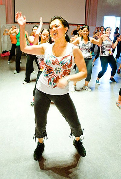 Vivian Li participates in a Zumba session during Yoga in Motion at the Liberty Grand Entertainment Complex in Toronto on April 10, 2011. The Sun sponsored the event that supports life-saving breast cancer research at the Samuel Lunenfeld Research Institute of Mount Sinai Hospital. The event yielded more than $150,000. (ERNEST DOROSZUK/QMI Agency/Toronto Sun)