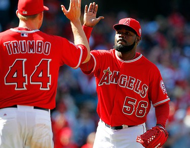 Los Angeles Angels first baseman Mark Trumbo (44) congratulates Angels relief pitcher Fernando Rodney (56) after beating the Toronto Blue Jays 3-1 in their MLB American League baseball game in Anaheim, California on April 10, 2011. (REUTERS)