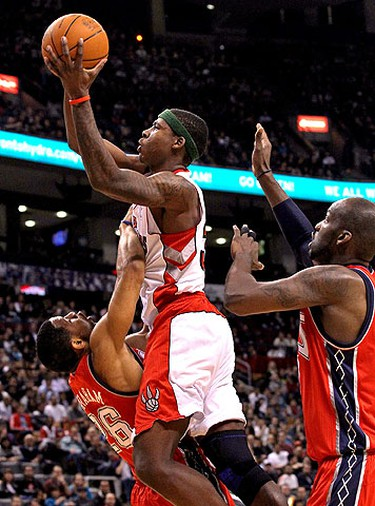 Ed Davis, of the Toronto Raptors, dunks on Stephen Graham, of the New Jersey Nets, during the first half of action at the Air Canada Centre in Toronto on April 10, 2011. (DAVE ABEL/QMI Agency/Toronto Sun)