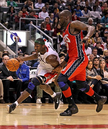 Julian Wright, of the Toronto Raptors, gets around Johan Petro, of the New Jersey Nets, during the first half of action at the Air Canada Centre in Toronto on April 10, 2011. (DAVE ABEL/QMI Agency/Toronto Sun)