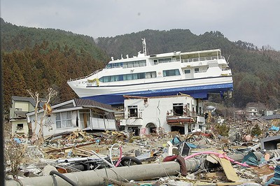 One of many boats tossed from the water by a violent tsunami in earthquake-battered Japan. (GlobalMedic Photo)