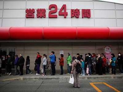 People line up for food and life supplies in front of a supermarket in Oshu, Iwate prefecture, after a 7.4 magnitude earthquake April 8, 2011. (REUTERS/Toru Hanai)