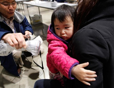 Two-year-old boy Showa Satou hugs his mother while being tested for possible nuclear radiation at an evacuation centre in Koriyama, Fukushima Prefecture, northern Japan, April 2, 2011, located about 70 km (44 miles) from the earthquake and tsunami-crippled nuclear reactor. Satou's family, which evacuated their town, located about 10 km from the reactor, did not show any harmful results. REUTERS/Kim Kyung-Hoon