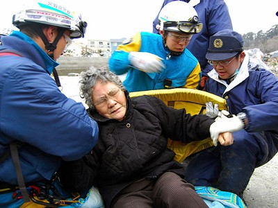 80-year-old Sumi Abe is helped by emergency workers after being rescued from under the rubble in Ishinomaki City, Miyagi Prefecture, northern Japan, in this picture taken by Nikkei Shimbun on March 20 , 2011. Sumi and her 16-year-old grandson Jin Abe were found alive on Sunday under the rubble in the Japanese city of Ishinomaki in northeast Japan, nine days after the region was devastated by a massive earthquake and tsunami, NHK public TV said. (REUTERS/Asahi Shimbun)
