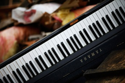 A damaged Yamaha piano is seen in the rubble in Kesennuma, Miyagi Prefecture, twenty days after the area was devastated by a magnitude 9.0 earthquake and tsunami March 31, 2011.   REUTERS/Damir Sagolj