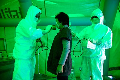 Medical staff use a Geiger counter to screen a woman for possible radiation exposure at a public welfare centre in Hitachi City, Ibaraki, March 16, 2011, after she evacuated from an area within 20km (12.4 miles) radius of the Fukushima Daiichi nuclear plant. REUTERS/Asahi Shimbun