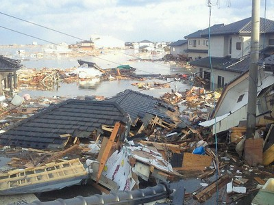 A man takes a picture from the second floor of his house, posting it to Twitter Friday morning following a deadly Tsunami in Japan. @_mego posted that it was safe to escape through the second floor of his house. (QMI Agency)