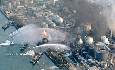 Fire boats battle a blaze at the Cosmo Oil facility in Ichihara City, Chiba Prefecture near Tokyo on March 12, 2011. (REUTERS/Kyodo)
