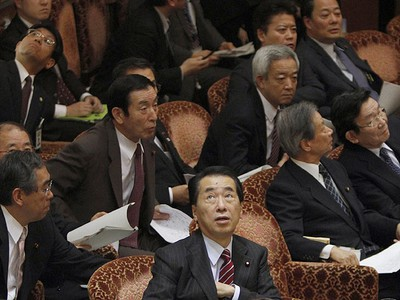 Japan's Prime Minister Naoto Kan (C) reacts he he feels an earthquake as he attends a committee meeting in the upper house of parliament in Tokyo March 11, 2011. (Reuters)