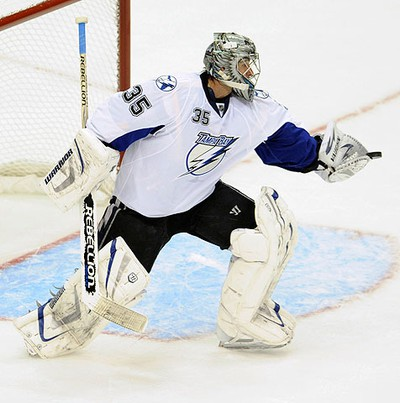 Tampa Bay Lightning goalie Dwayne Roloson (35) makes a save against the Pittsburgh Penguins during the second period of Game 1 of their NHL Eastern Conference quarter-final hockey game in Pittsburgh, Pennsylvania on April 13, 2011. (REUTERS)