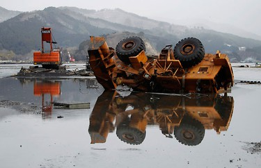 Damaged heavy equipment are seen at a port in Ofunato, Iwate prefecture, April 4, 2011, after the area was devastated by a magnitude 9.0 earthquake and tsunami on March 11.   REUTERS/Toru Hanai