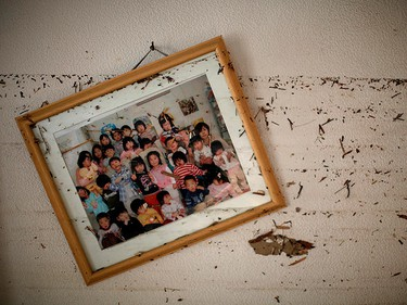 A picture frame and water marks are seen over the wall of a kindergarten destroyed by the March 11 earthquake and tsunami in Ishinomaki, northern Japan, April 7, 2011. (REUTERS/Carlos Barria)