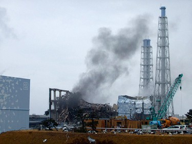 Smoke is seen coming from the area of the No. 3 reactor of the Fukushima Daiichi nuclear power plant in Tomioka, Fukushima Prefecture in northeastern Japan in this handout photo distributed by the Tokyo Electric Power Co. on March 21, 2011. (REUTERS/Tokyo Electric Power Co.)