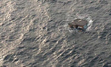 A Japanese home is seen adrift in the Pacific Ocean in this photograph released on March 14. REUTERS/U.S. Navy photo by Mass Communication Specialist 3rd Class Dylan McCord/Handout
