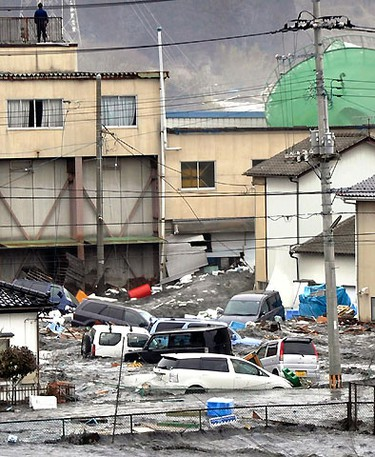 Streets are flooded after a tsunami and earthquake in Kesennuma city, Miyagi Prefecture March 11, 2011. REUTERS/YOMIURI