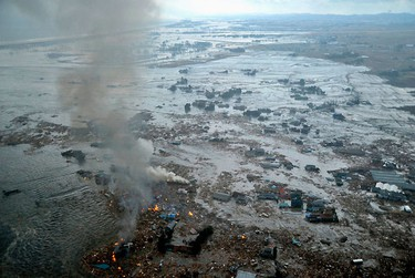 Fires burn in a harbour following an earthquake and tsunami in Natori City, Miyagi Prefecture, northeastern Japan,  March 11, 2011. REUTERS/KYODO