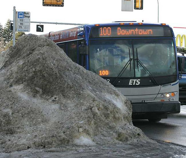 Feb. 4: A bus stop sign is surrounded by a huge windrow on the corner of 149 St. and 82 Avenue in Edmonton. (LAURA PEDERSEN/EDMONTON SUN)