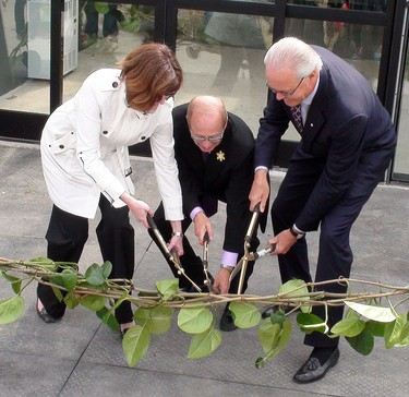"""From left, Assiniboine Park Conservancy president and CEO Margaret Redmond, Mayor Sam Katz and Assiniboine Park Conservancy chairman Hartley Richardson take part in a """"vine cutting"""" as the Assiniboine Park Conservancy gave a sneak peak to media of the new $2.2-million Toucan Ridge exhibit that opens to the public April 20, 2011."""