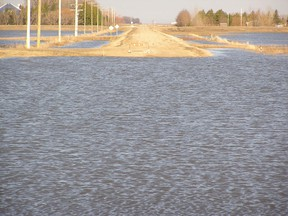 This RM of Morris road is closed because of flood water flowing through the Morris River Diversion near Rosenort on April 25, 2011.