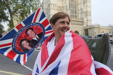 Royal fan Linda Hartwick from New York City is all smiles as she camps in front of the Westminster Abbey in London, UK Tuesday April 26, 2011.  (ANDRE FORGET/QMI AGENCY)