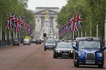 Massive British flags are seen on the Mall heading to Buckingham Palace in London, UK Tuesday April 26, 2011.   (ANDRE FORGET/QMI AGENCY)