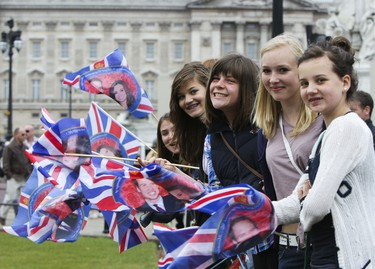 (R, L) Anna, Annabelle, Laura, Francesca, Neive, Bibi, Katrine and Abbey from Harpenden in Hertfordshire cheer on with Will and Kate flags in from of the Buckingham Palace in London, UK Tuesday April 26, 2011.  (ANDRE FORGET/QMI AGENCY)