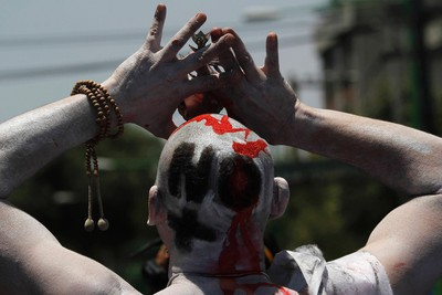 "A demonstrator's head is pictured painted with a message reading, ""No more blood"" during a march on the streets in Mexico City May 8, 2011. Thousands of Mexicans on Sunday marched into the capital city to protest the wave of killing that has claimed 38,000 lives since President Felipe Calderon launched his war on drug gangs in late 2006.   REUTERS/Carlos Jasso (MEXICO - Tags: CIVIL UNREST CRIME LAW SOCIETY POLITICS)"