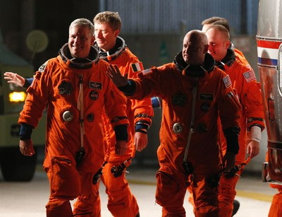 Space shuttle Endeavour crew (L to R) Pilot Gregory Johnson, Roberto Vittori, Commander Mark Kelly and Mission Specialist Michael Fincke depart crew quarters for launch pad 39A at the Kennedy Space Center in Cape Canaveral, Florida May 16, 2011. REUTERS/Molly Riley (UNITED STATES - Tags: SCI TECH)