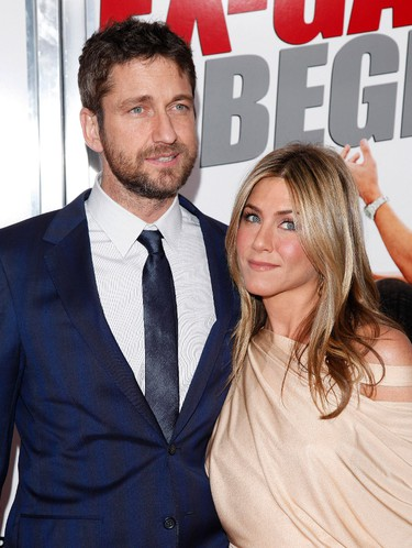 """Actors Gerard Butler and Jennifer Aniston arrive to the premiere of """"The Bounty Hunter"""" at The Ziegfeld Theater in New York, on Tuesday, March 16, 2010. (AP Photo/Peter Kramer)"""