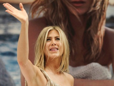 """Actress Jennifer Aniston greets fans after an autograph signing session as part of promotional activities for her fragrance """"Jennifer Aniston"""" in Mexico City March 10, 2011. REUTERS/Henry Romero"""